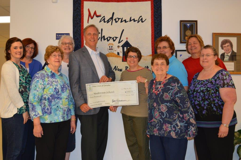Pilot Club of Omaha presents a check for $3,200 to Madonna School President, Jay Dunlap, after the 2015 Trivia Night.