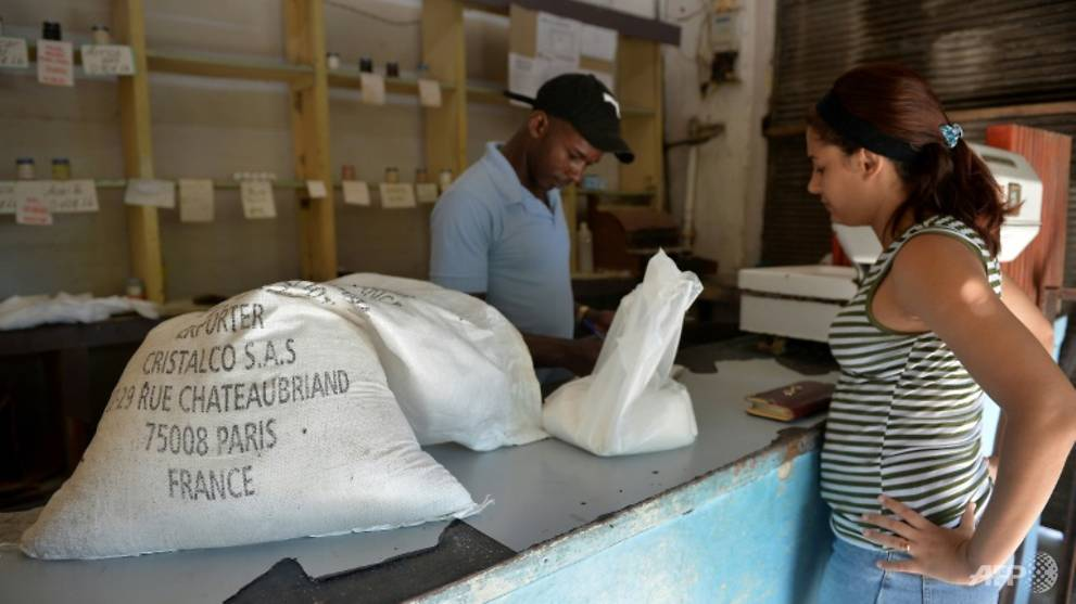 a-woman-buys-sugar-produced-in-france-at-a-grocery-store-in-the-cuban-capital-havana----experts-are-hoping-the-sector-can-rebound-on-the-island-possibly-with-some-foreign-investment-1540352832496-7.jpg