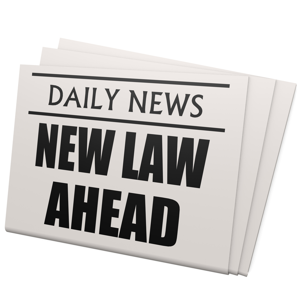Newspaper-that-reads-new-law.jpg.crdownload.jpg