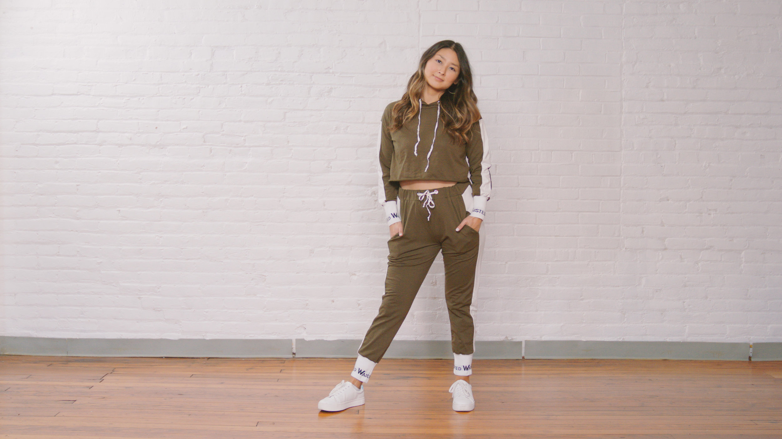 waisted logo match set - A little bit of both. This match set is a perfect balance of basic with a hint of flare. The olive is a great neutral color and the added details on the hems make the look more of a statement outfit.