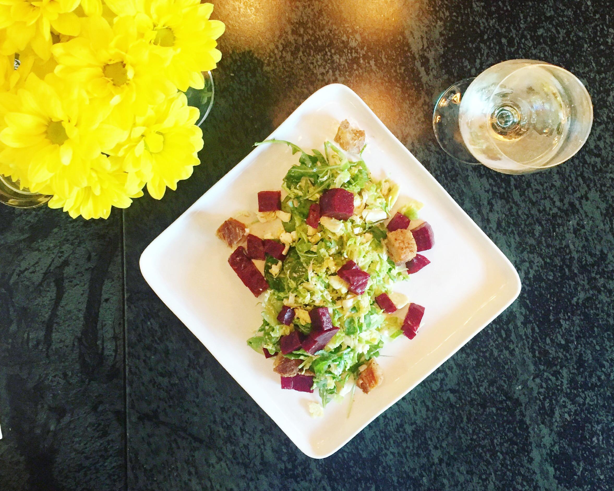Beet Salad @ Reid's Fine Food   Beets, shaved brussels, arugula, lardon, goat cheese, and truffle vinaigrette.
