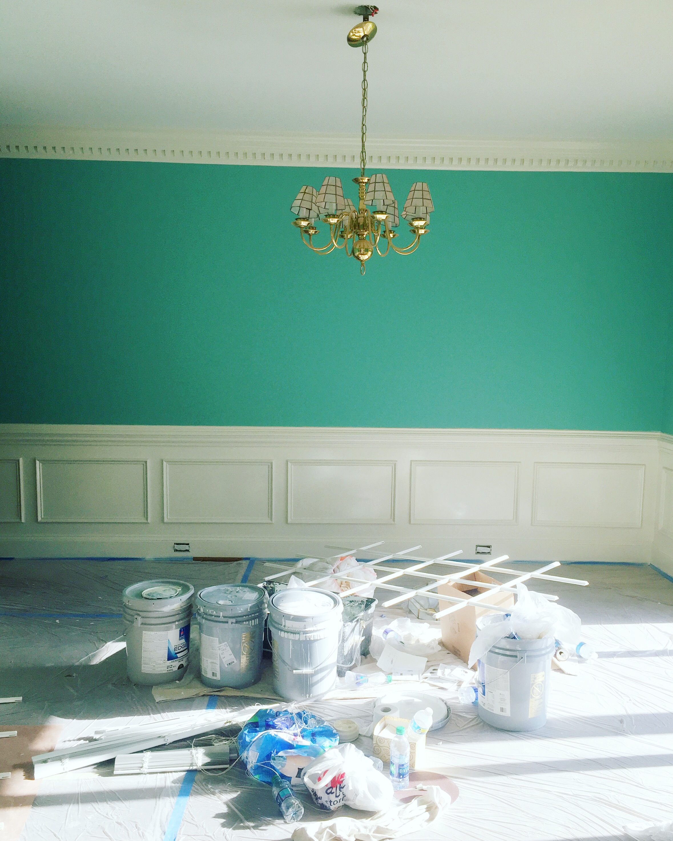 Dining room getting a fresh coat of sea foam green.