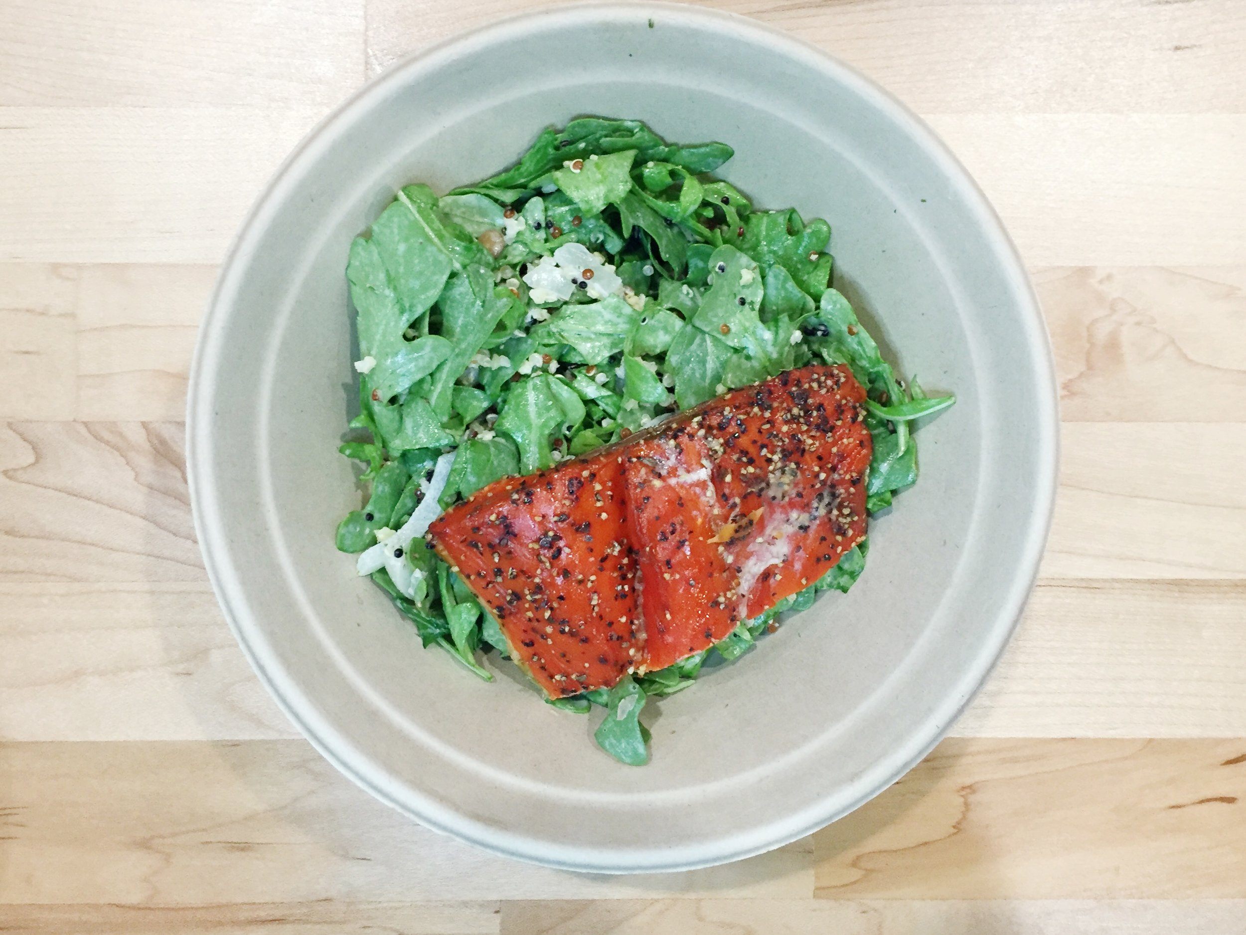 Wild Smokehouse Salmon Plate  | Smoked wild sockeye salmon, quinoa, lentil and millet blend, pickled sweet onions, and arugula. Tossed in Dill Caraway dressing.