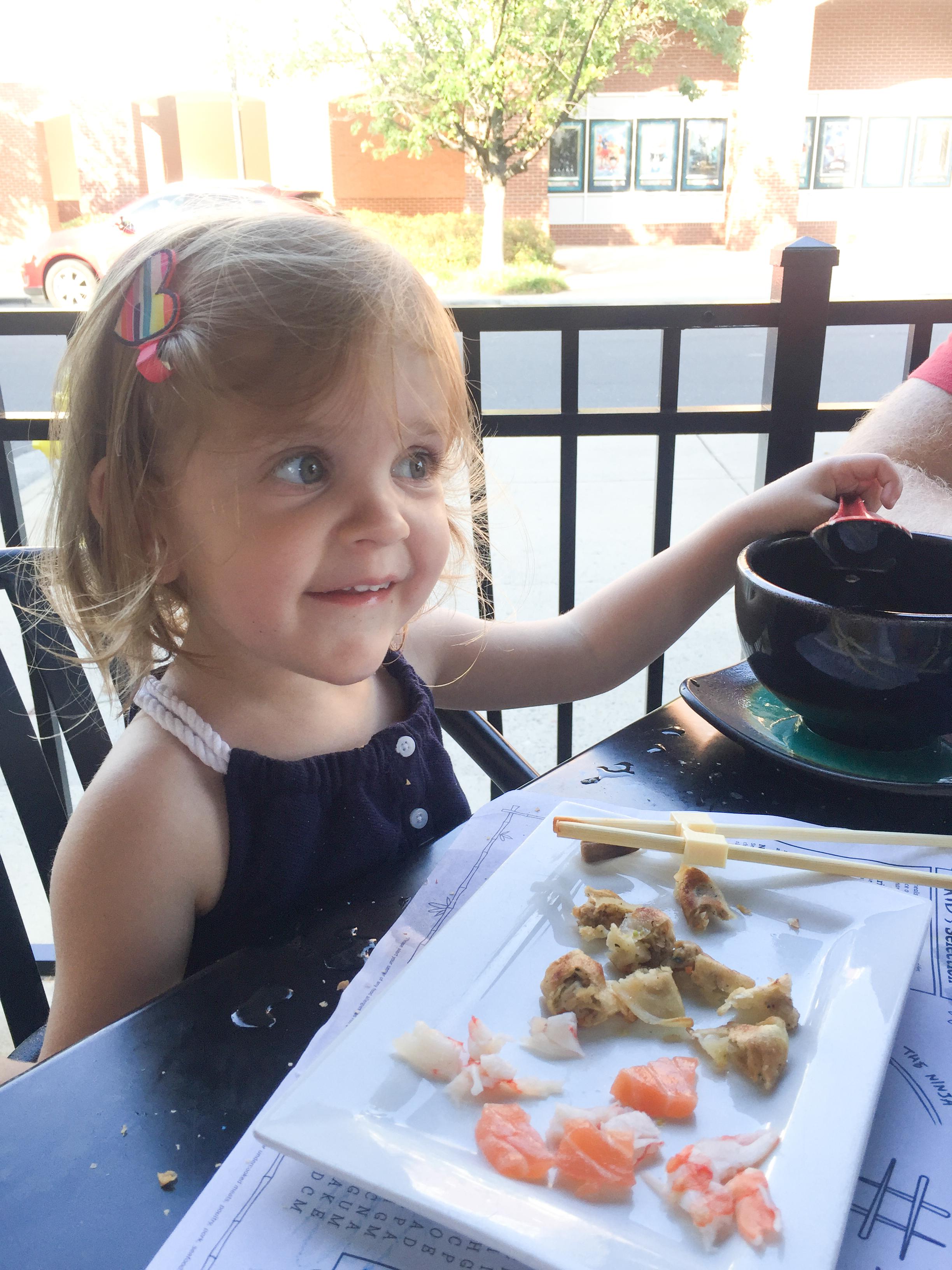 eez-fusion-sushi-huntersville-nc-toddler-eating-sushi