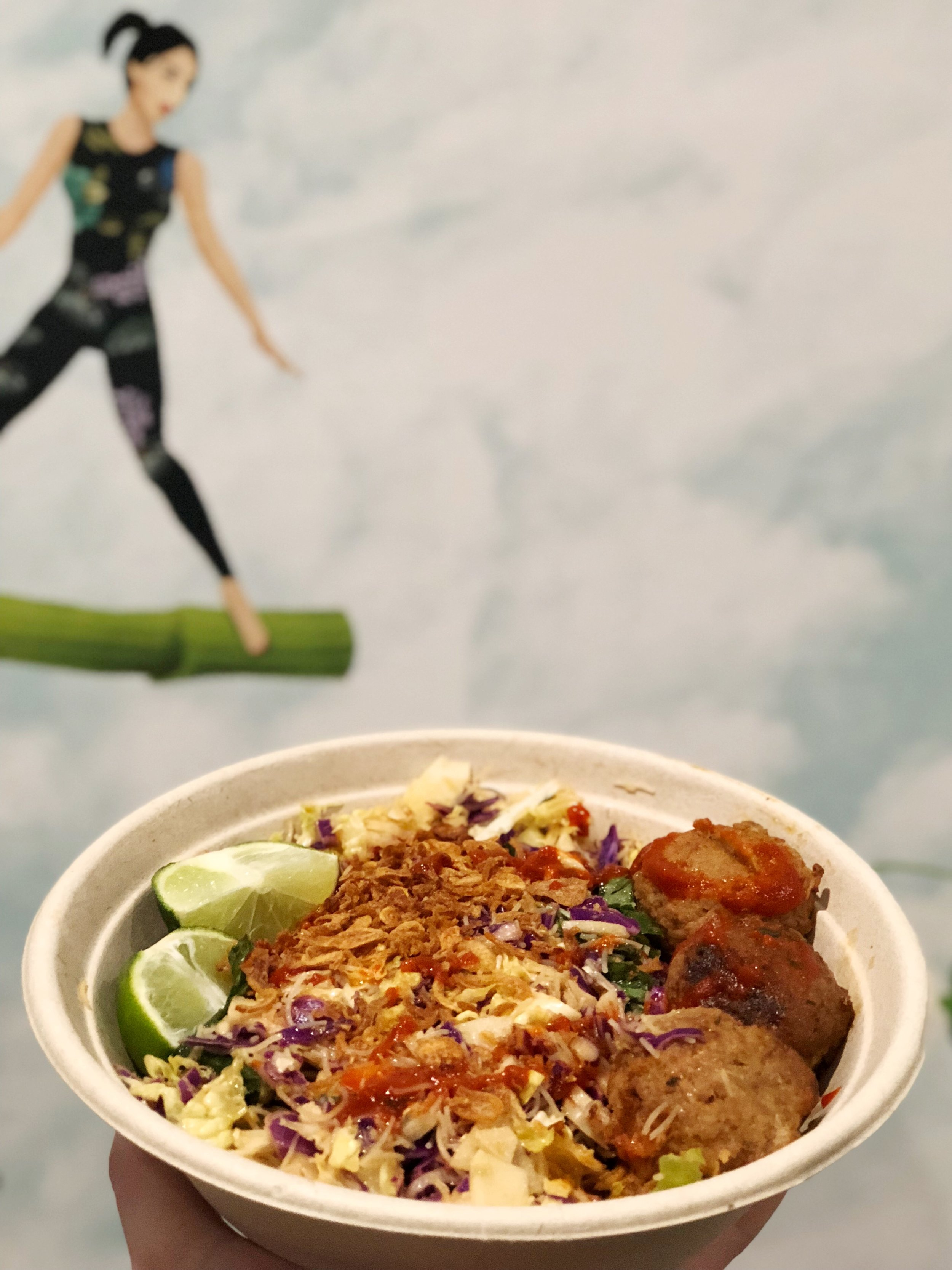 VIETNAMESE MEATBALL NOODLE BOWL:Warm lemongrass turkey meatballs, chilled rice noodles, pickled hearts of palm, English cucumbers, crispy shallots, cabbage & herb blend,SPICY TAMARIND VINAIGRETTE,A DRIZZLE OF SRIRACHA, and A WEDGE OF LIME. | c/o CHOPT