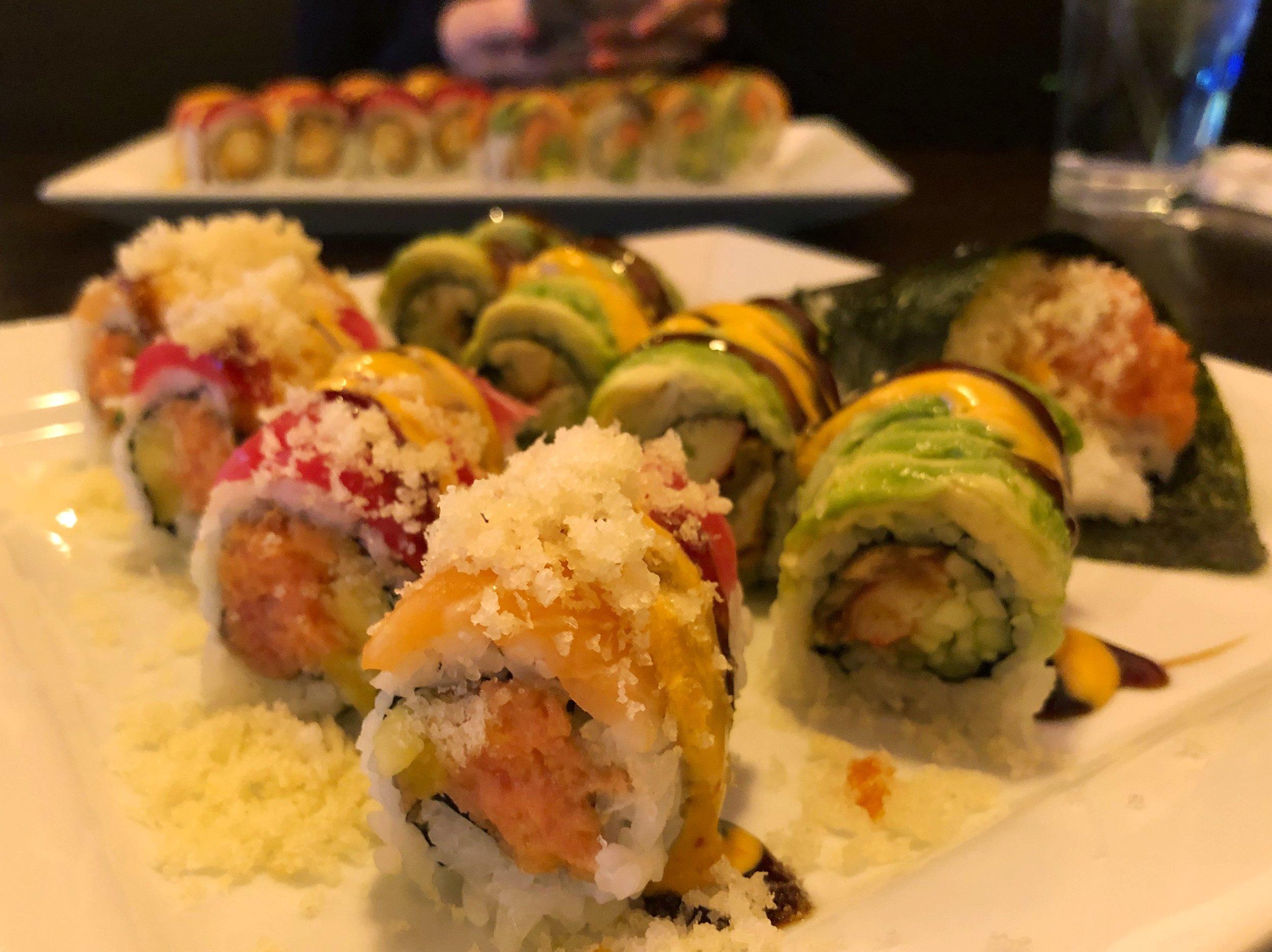 Tiger Roll | Spicy Tuna, crunch, mango with tuna, salmon, crunch, masago on top  Dragon Roll | Eel, cucumber, crabmeat with sliced avocado on top, eel sauce  Spicy Tuna Hand Roll