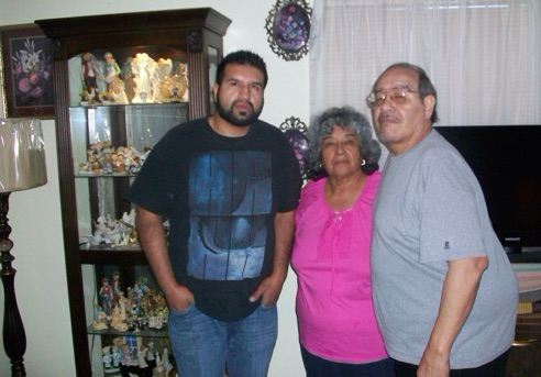 Julian Torres with his parents, prior to his incarceration.