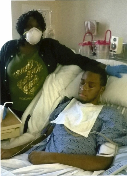 Nathan King on his deathbed, with his mother. Photo provided by his family.