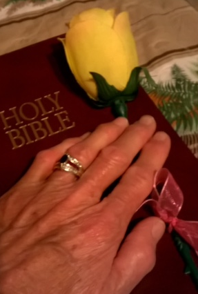 Angel Rose's photo of her hand on the Bible.