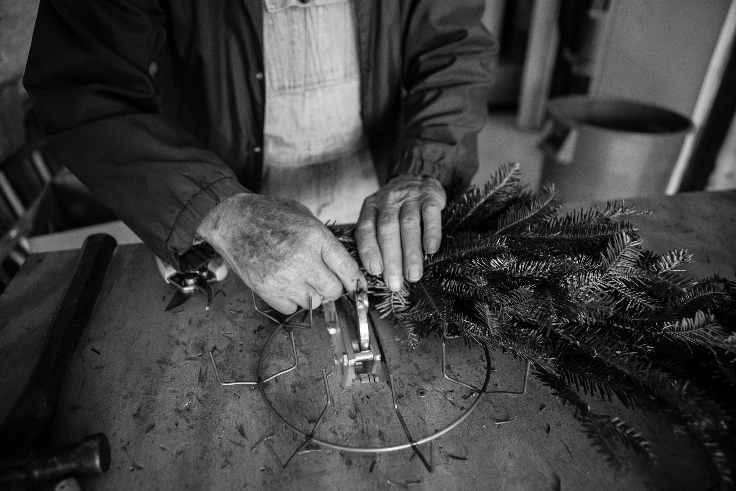 Man making Christmas wreaths in Lenoir, North Carolina.