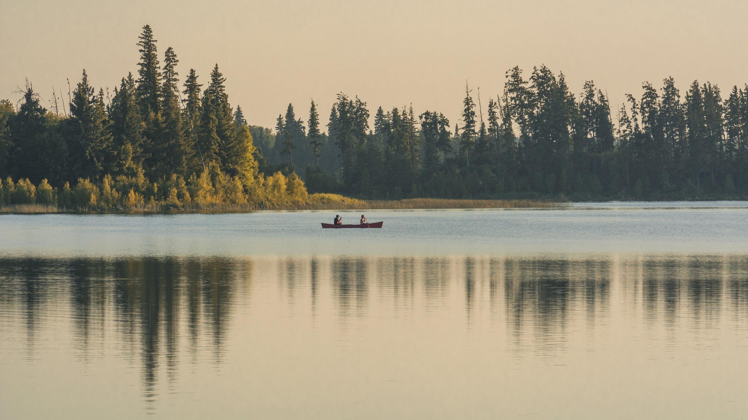 Canoe and Sunset at Astotin Lake, Elk Island National Park,Alberta, Canada