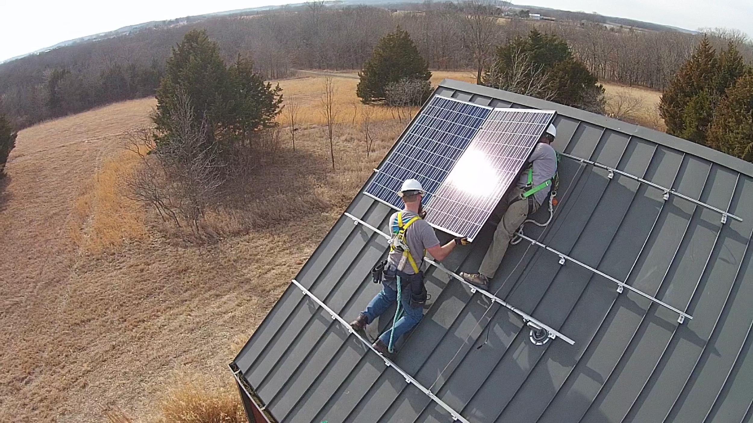 Cromwell Solar crew installing a panel © 2015 Cromwell Environmental