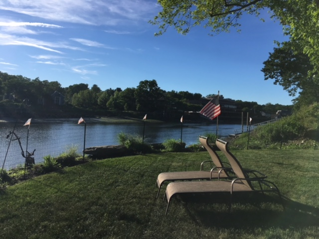 A great view of the Saugatuck River in Westport, Connecticut. Beautiful view and clean landscape with grasses, bushes, etc. We felt packing the landscape with annuals was't necessary.
