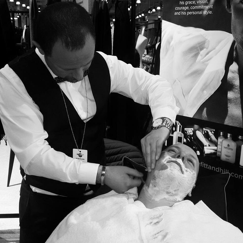 Peter Palushi, owner of Gentleman's Barber Spa in White Plains, performs the Royal Shave for Truefitt & Hill