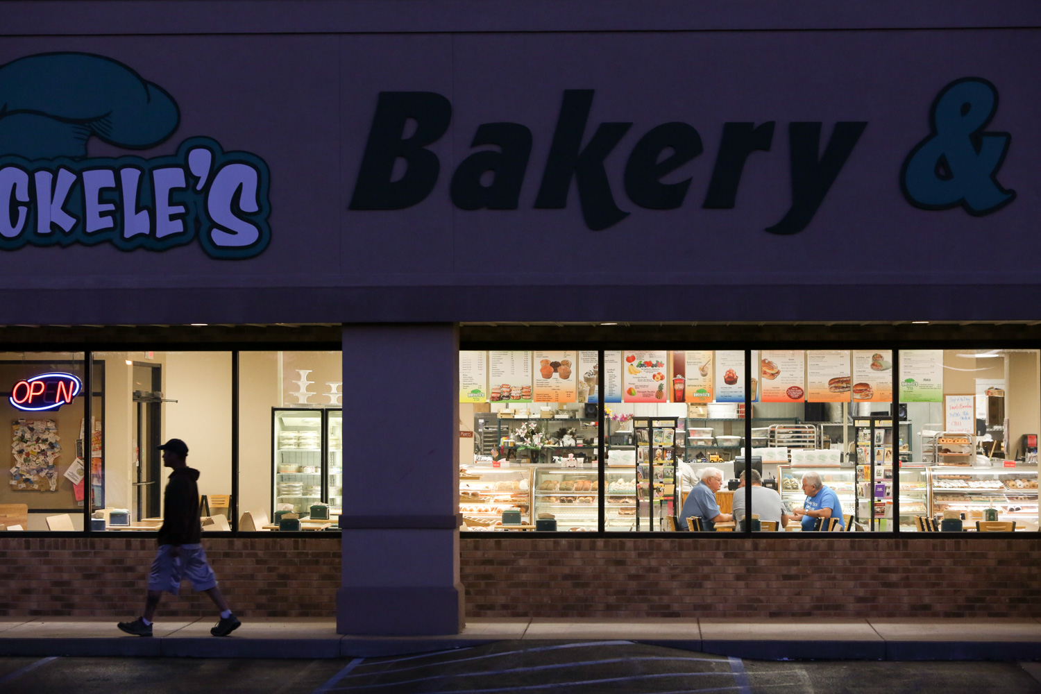 A patron exits the Hoeckele's bakery, an establishment that has been in operation since 1937. The bakery opens at 3:00AM – typically to a line of faithful patrons.