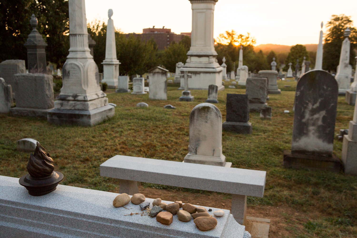 Several stones sit atop a tombstone in the Congressional Cemetery in Washington, D.C.