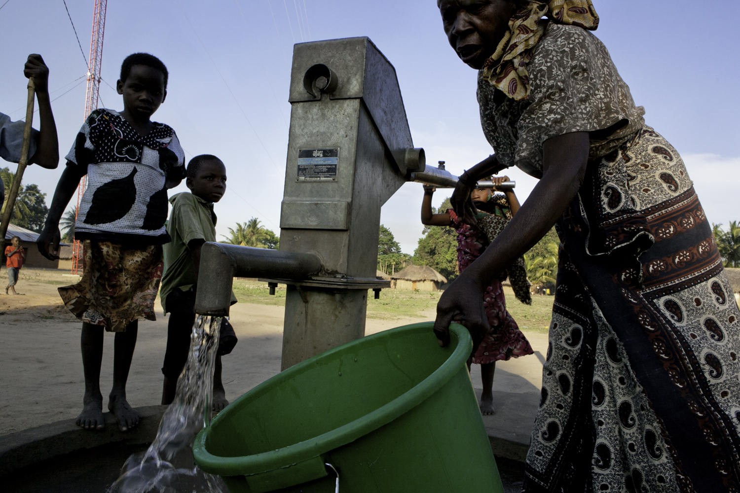 After well rehab is successful, people of all ages utilize the pump to gather water.