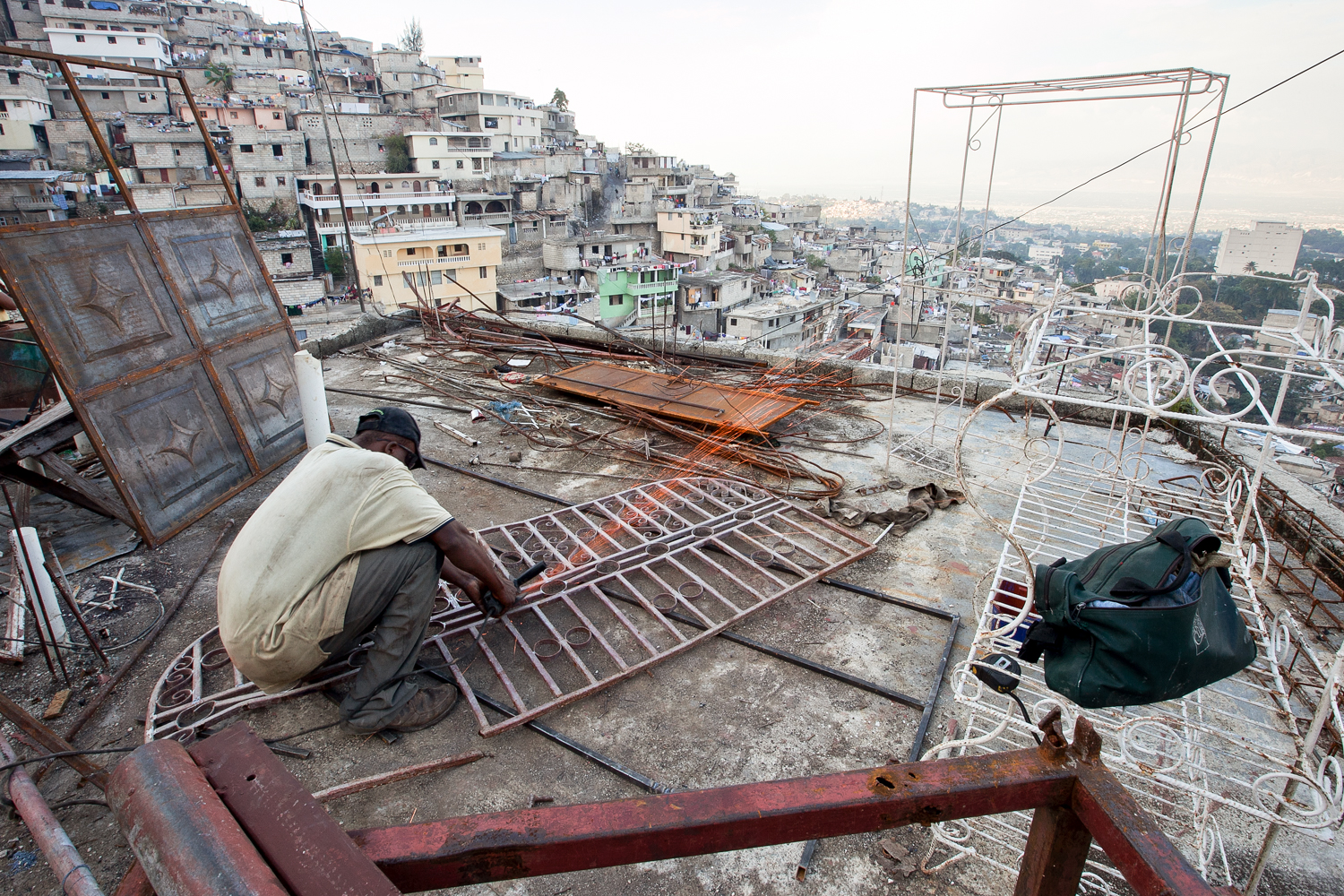 Views into overbuilt and crowded cities outside of the village act as a vivid reminder that progress remains thwarted and choked as few people attempt to rebuild and develop.