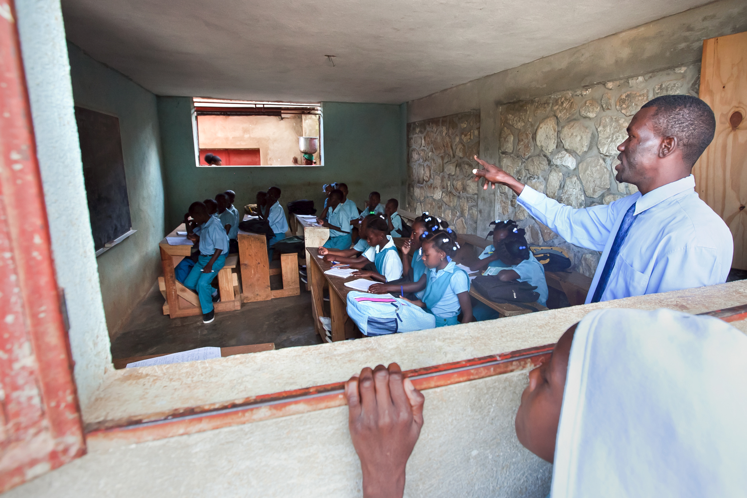The opportunity for free education at Gramothe's school draws children from miles away. Some walk four hours a day to attend in return for the prospect of a brighter future.