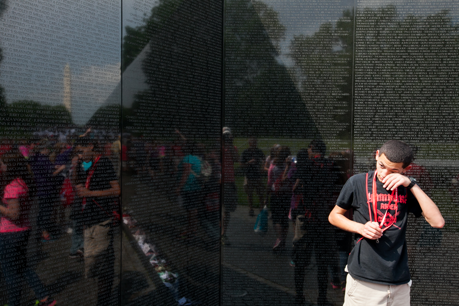 Wiping a tear at the Vietnam Memorial