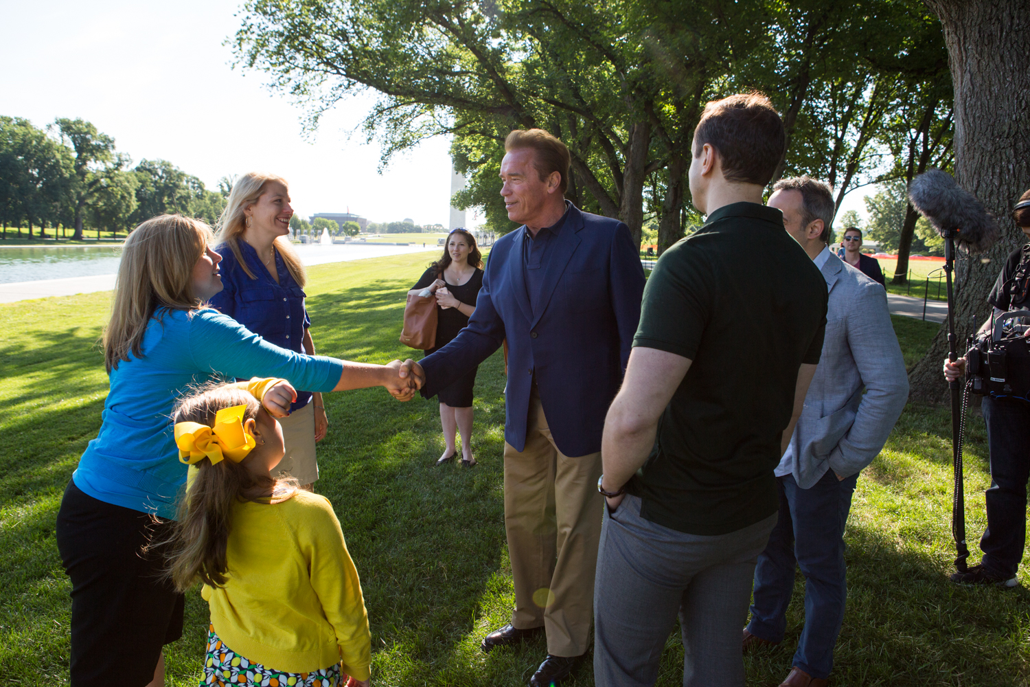 Arnold Schwarzenegger greets members of a military family in Washington, D.C. during  National Geographic Channel 's production of  Years of Living Dangerously .