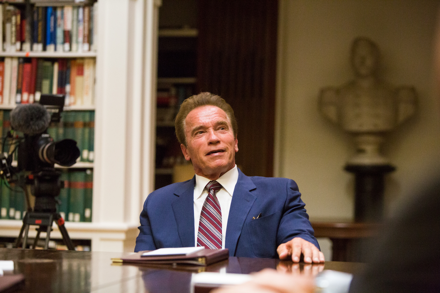 Arnold Schwarzenegger conducts an interview in Washington, D.C. during  National Geographic Channel 's production of  Years of Living Dangerously .