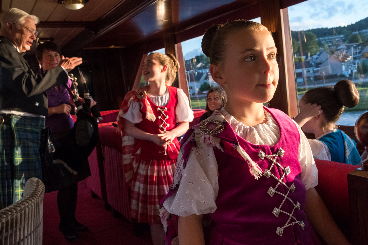 A young Highland dancer waits for her chance to perform for guests aboard Lord of the Glens.