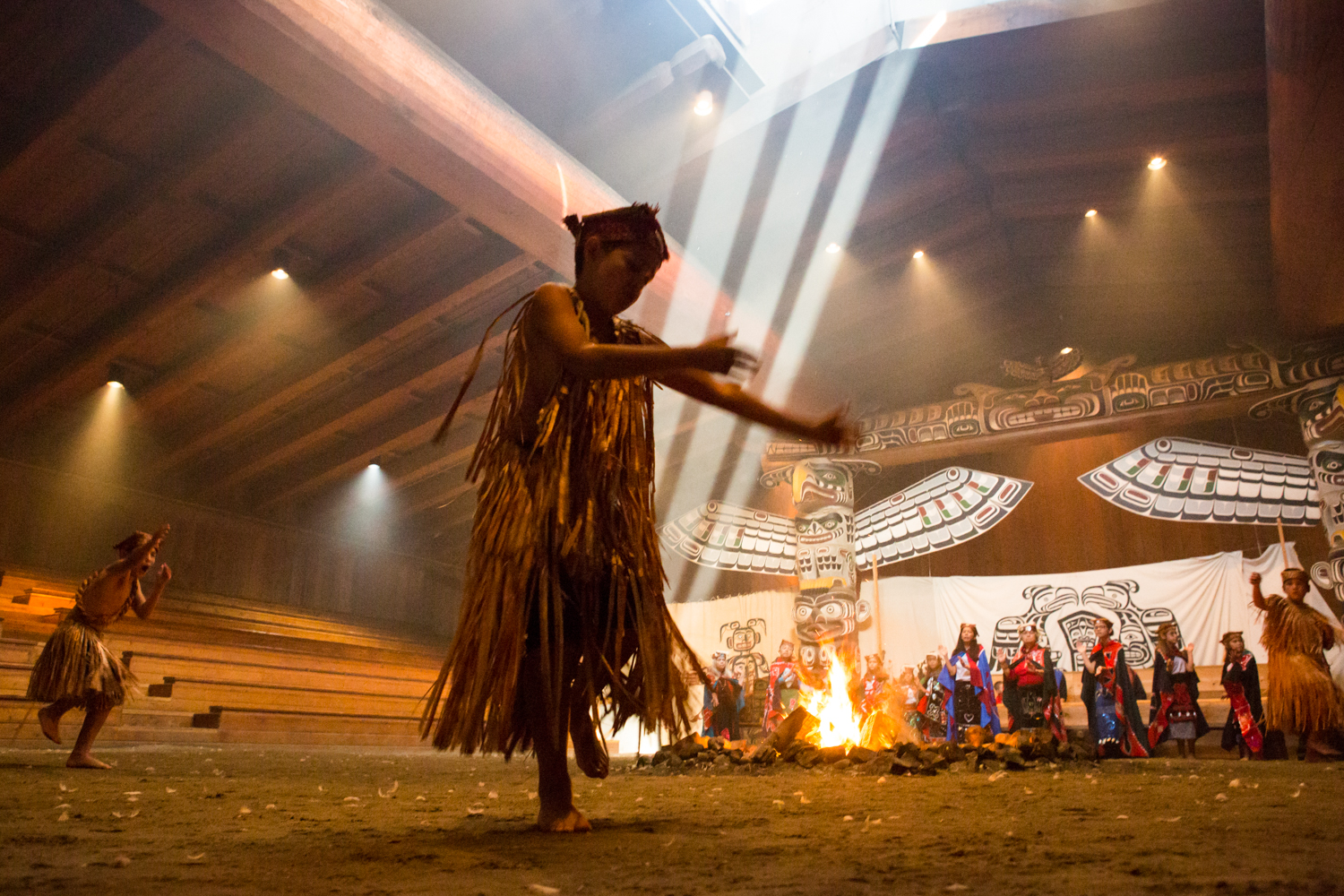 A young boy, part of the U'mista Cultural Center Group, dances within a traditional longhouse in Alert Bay, near the coast of Vancouver Island, British Columbia.