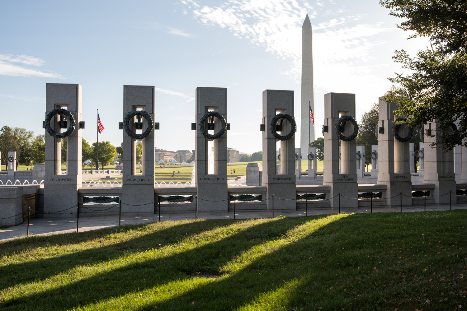 The World War II Memorial in Washington, D.C. casts long shadows in the morning light.