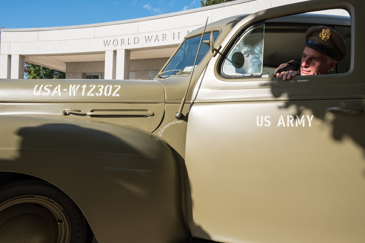Chris Gabers, a war re-enactor with the Allied Airmen's Preservation Society, parks a US Army vehicle near the World War II Memorial in Washington, D.C. during an Honor Flight event. Honor Flight is when veterans from around America visit the memorials on The National Mall.