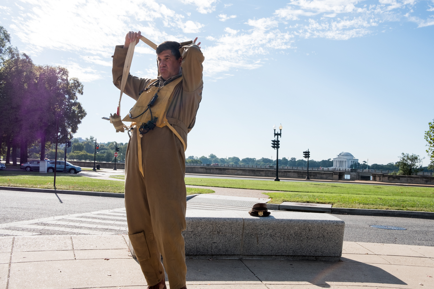 Phil Escobar, a war re-enactor with the Allied Airmen's Preservation Society, dons his military clothing near the World War II Memorial in Washington, D.C. during an Honor Flight event. Honor Flight is when veterans from around America visit the memorials on The National Mall.