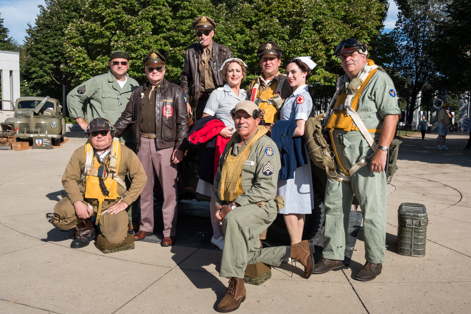 The Allied Airmen's Preservation Society poses for a portrait near the World War II Memorial in Washington, D.C. during an Honor Flight event. Honor Flight is when veterans from around America visit the memorials on The National Mall. The Allied Airmen's Preservation Society is a group of volunteers who gather during events to honor, preserve and remember veterans. Members are: Chris Gabers (standing cigarette), Standing L to R, Dave Nichols, Bill Groff, Laura Shaw, Phil Escobar, Hailey Shaw, Vance Valenzo, Kneeling L to R, Will Snyder, Joe Becker.