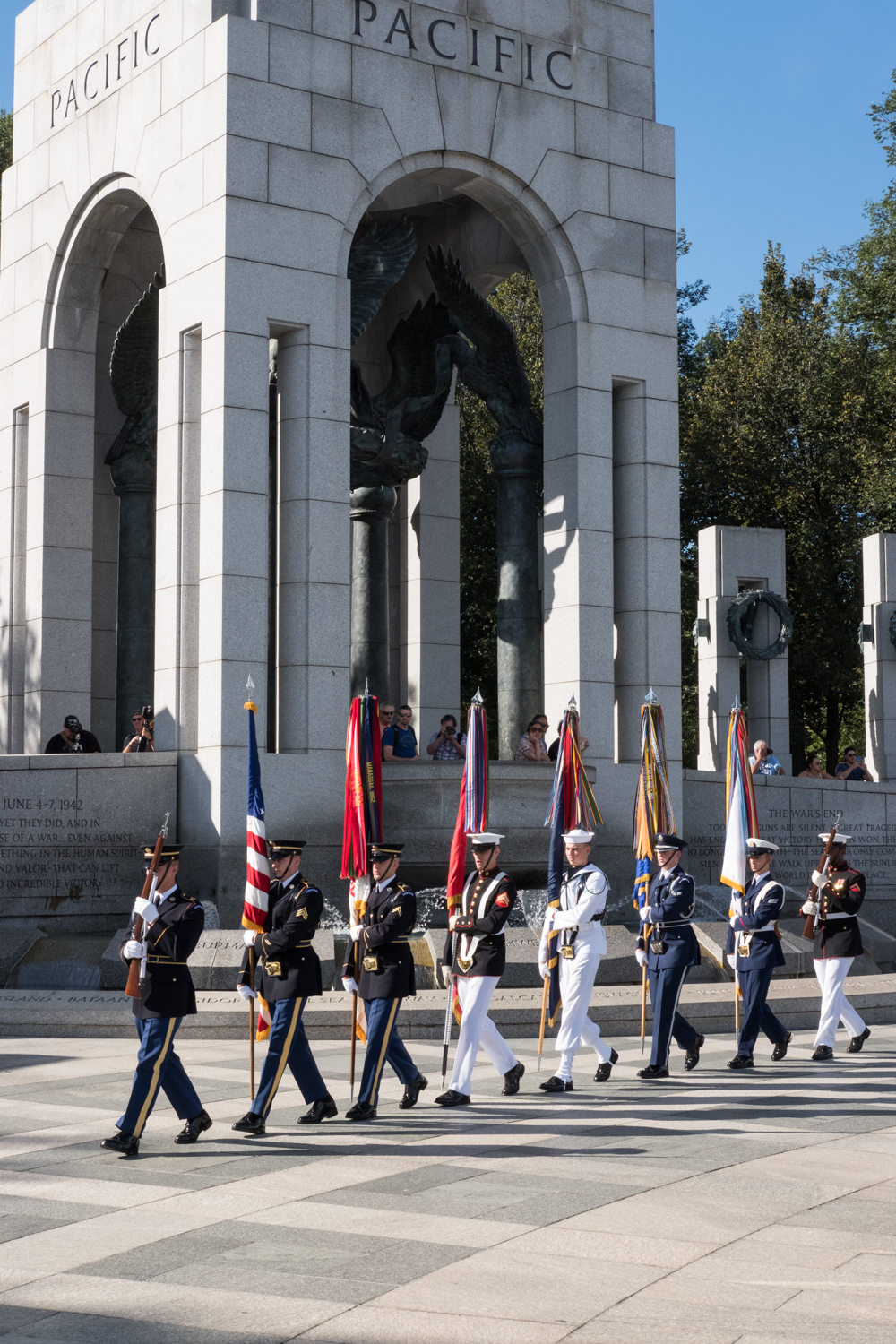 The Color Guard marches through the World War II Memorial in Washington, D.C. during an Honor Flight event. Honor Flight is when veterans from around America visit the memorials on The National Mall.