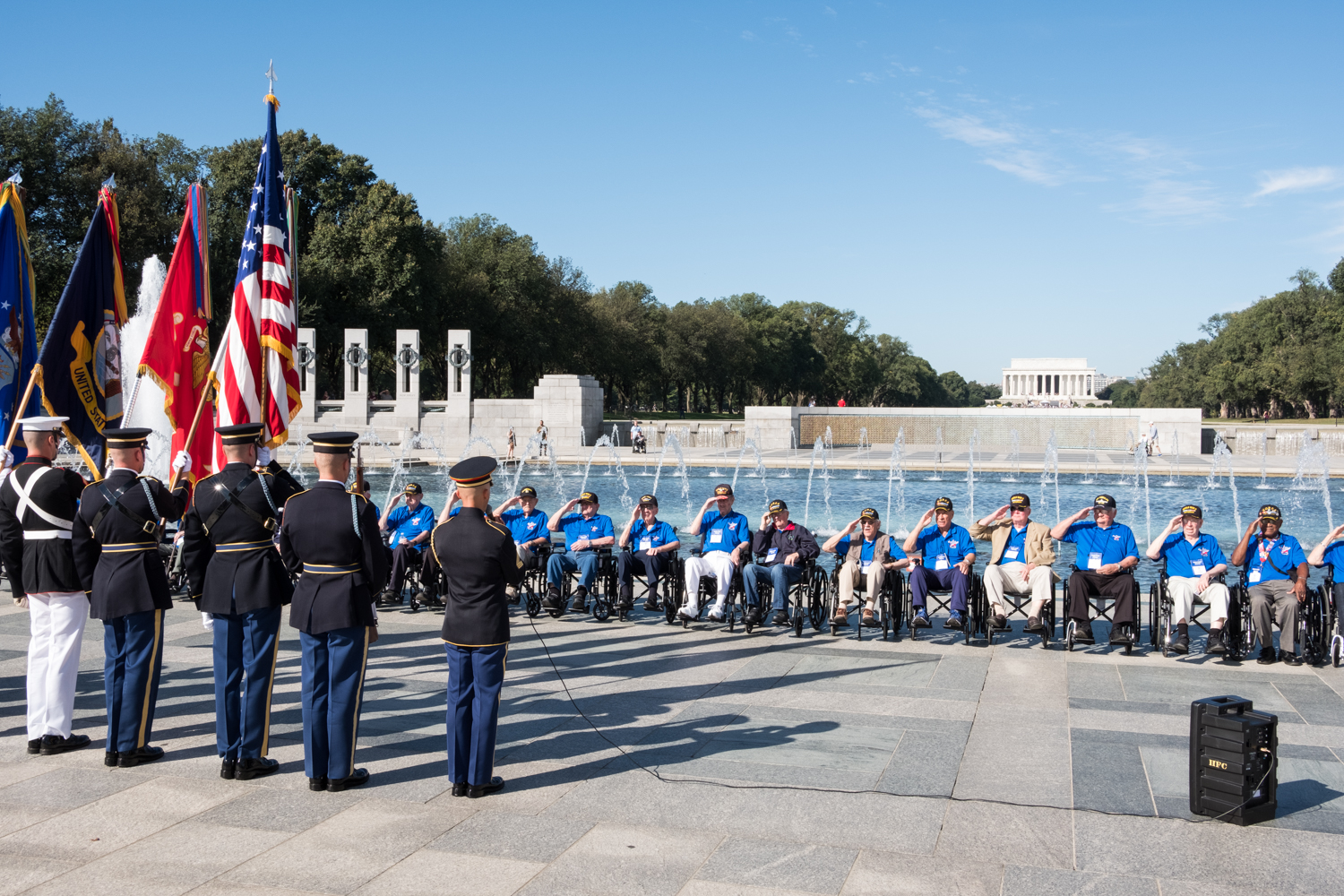 Veterans from Houston, Texas, line up at the World War II Memorial in Washington, D.C. and salute The Color Guard during an Honor Flight event. Honor Flight is when veterans from around America visit the memorials on The National Mall.