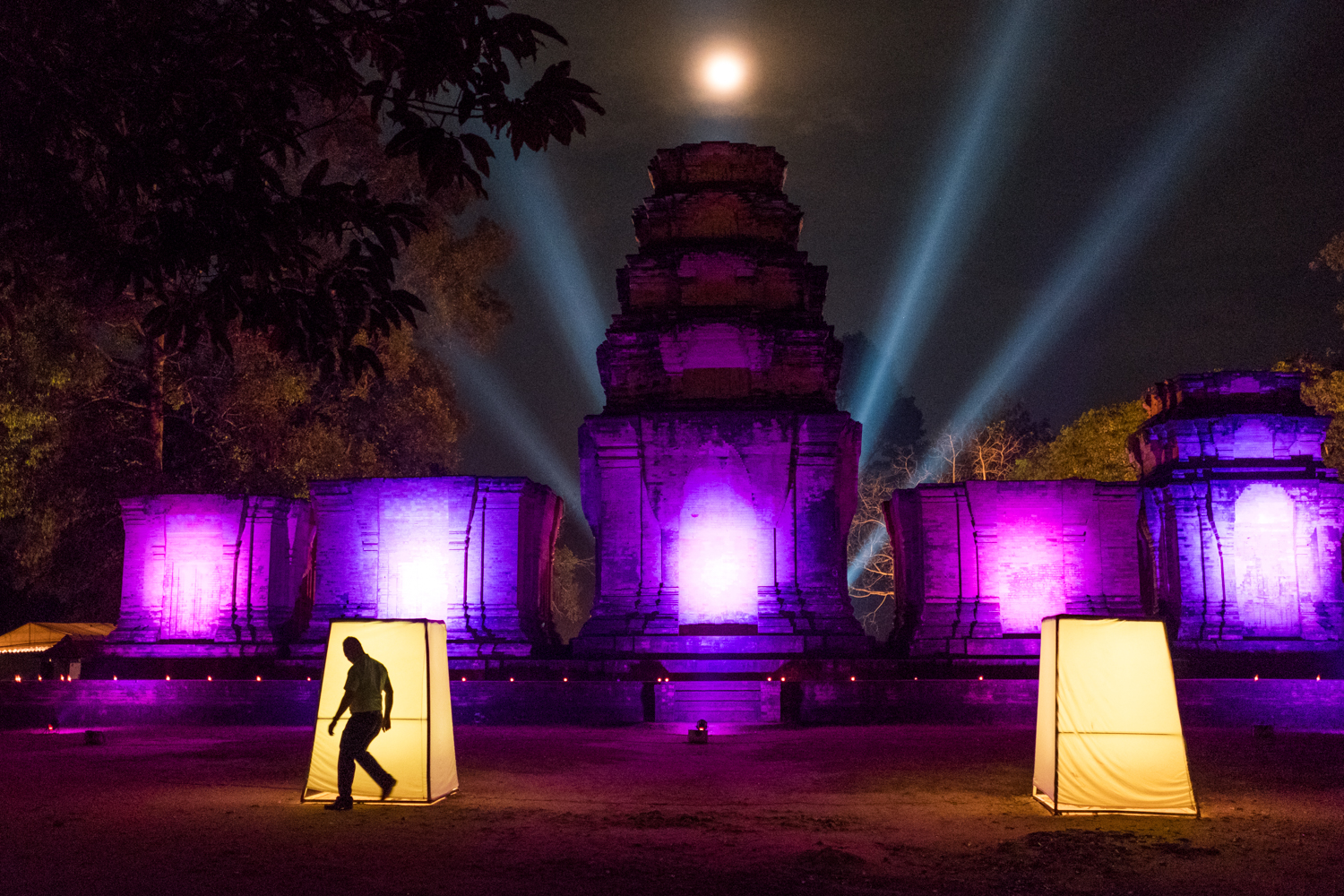 A full moon shines through the haze above Prasat Kravan, a 10th-century temple located in Angkor, Cambodia.