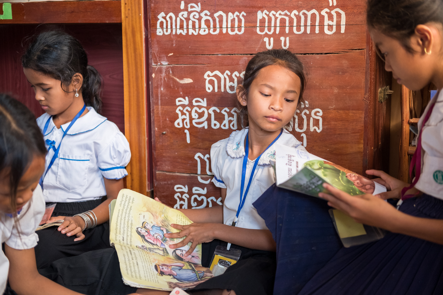 Several girls read books inside the library of a local grammar school in the village of Kampong Tralach, Cambodia.