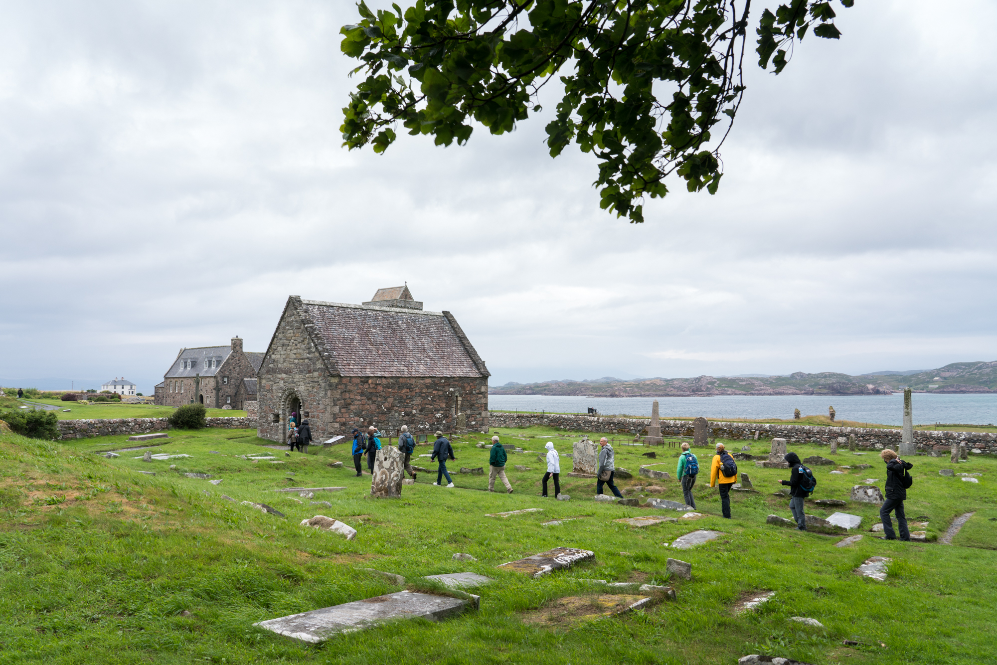 Guests walk through the cemetery on Iona, a place steeped in religious history.