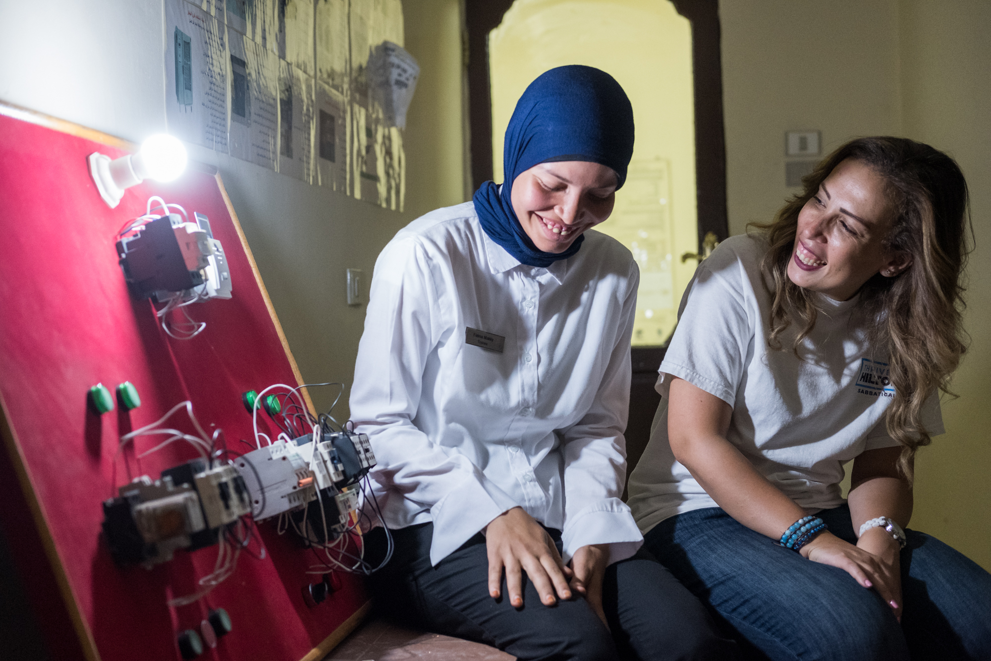 Ingy Helal (right) poses for a portrait with Fatma (left), a trainee in the Engineering/Electrical Department at Hilton Sharm Waterfalls Resort in Sharm El Sheikh, Egypt. Ingy's training program brought young adults from Upper Egypt into the tourism and hospitality industry.