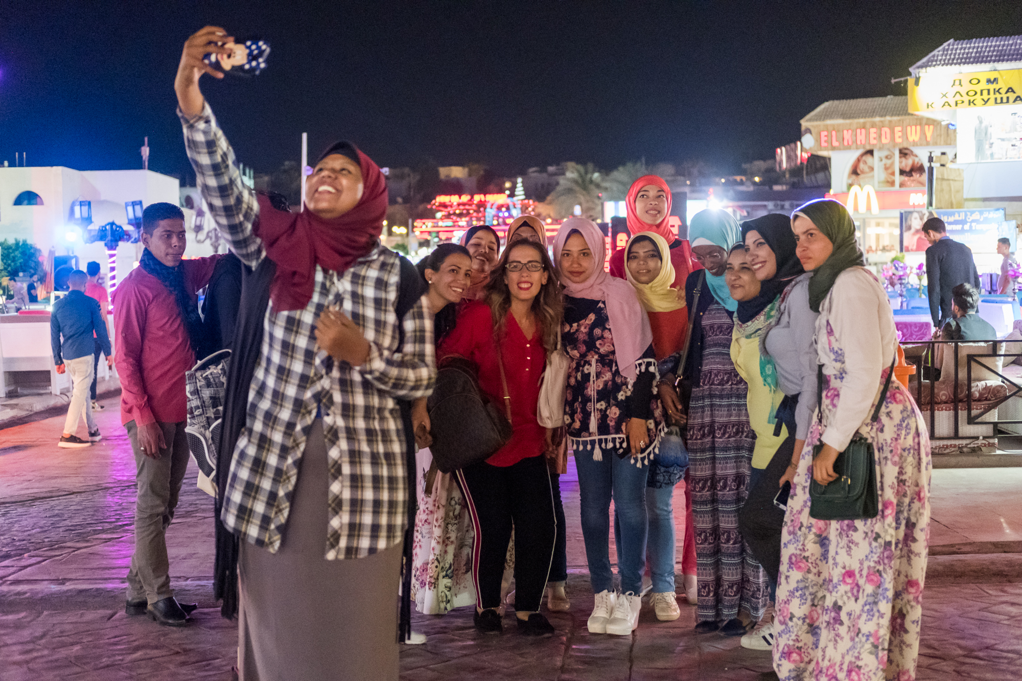 Ingy Helal (center in red) joins the initial group of 15 participant trainees for an outing at Naama Bay Night Market.