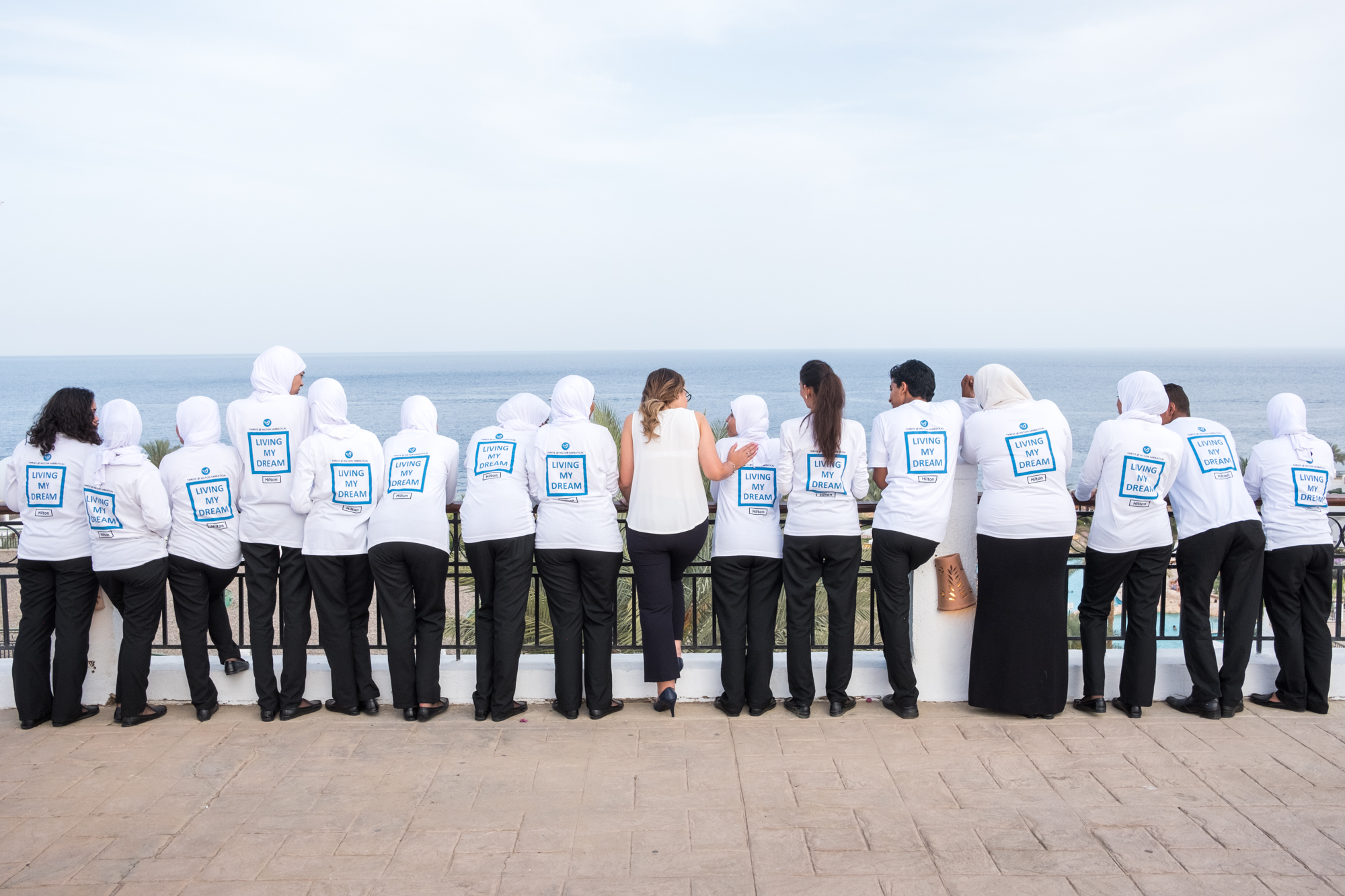 After holding a ceremony to honor the training program participants, Ingy and the original 15 training participants pose for a portrait at the resort near the Red Sea.