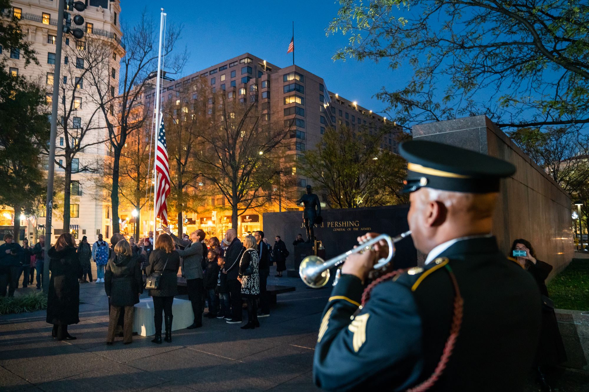 To conclude the evening, guests lowers the American flag as the 369th Experience Band director, Dr. Isrea Butler, performs Taps.