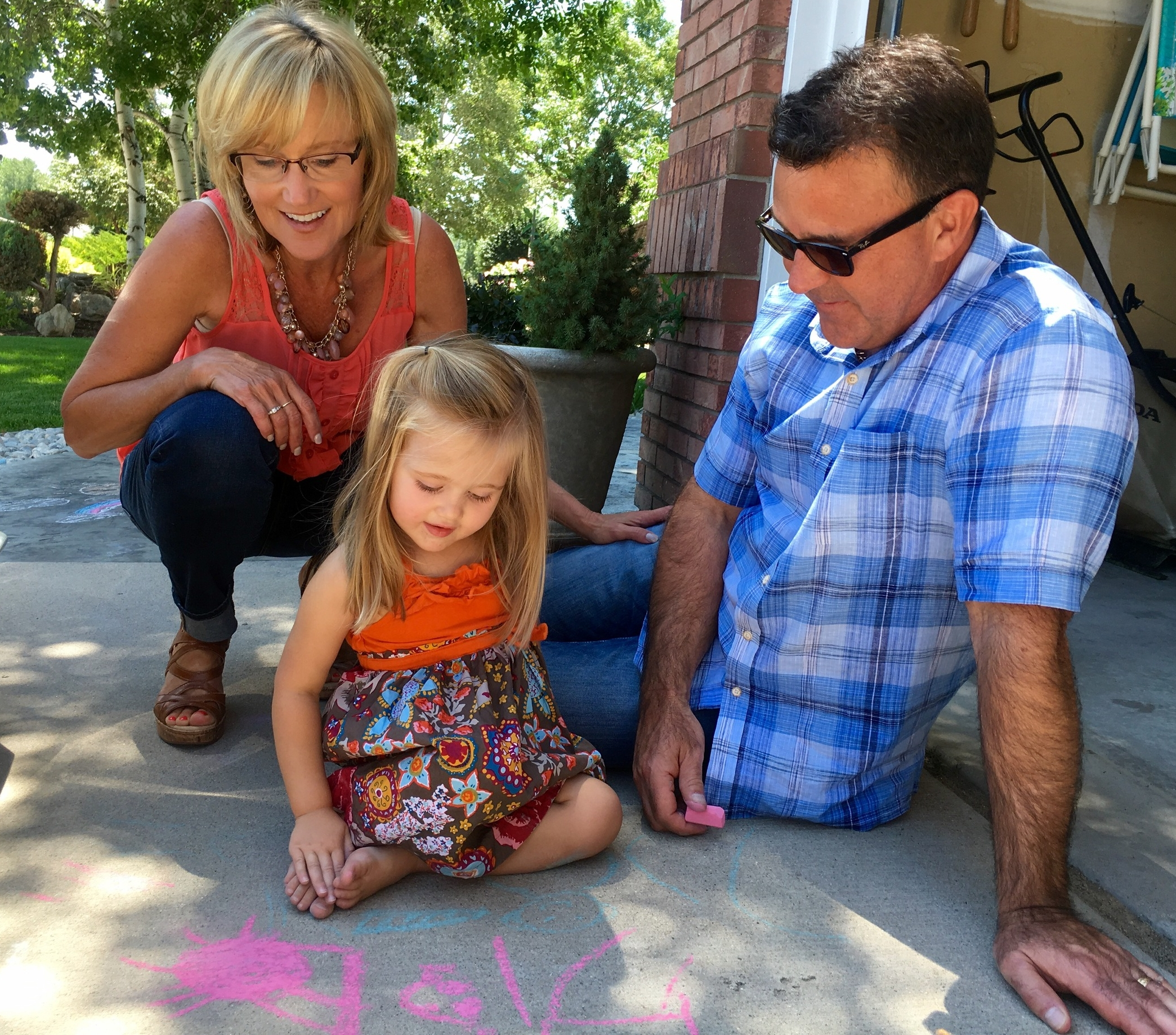 Two-year-old daughter, Cambry, drawing pictures with the grandparents
