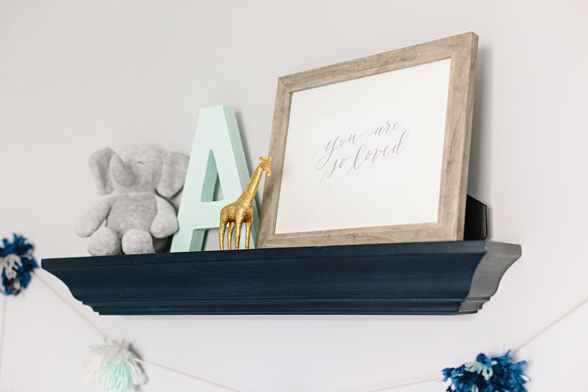 You are so loved | Calligraphy Nursery Art Print by Dreams & Nostalgia. Photographed by Cassie Schott Photography