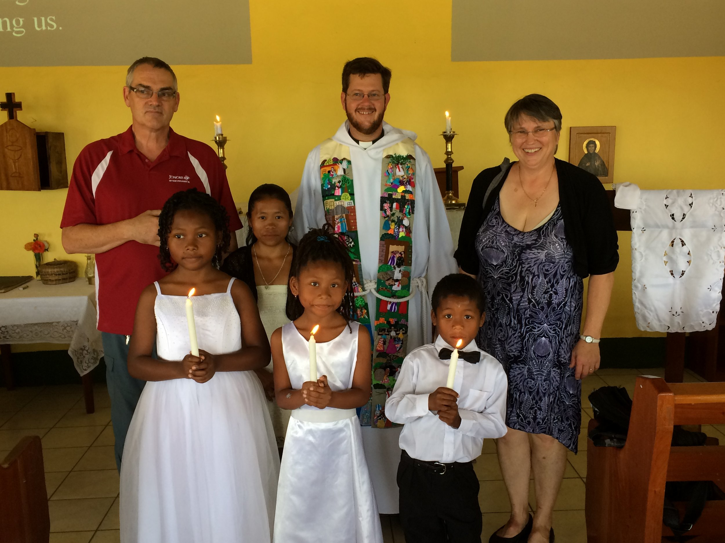 Here I am with our two lay ministers in charge of Evensong (far left and right) at a baptism Easter Sunday in Georgeville.