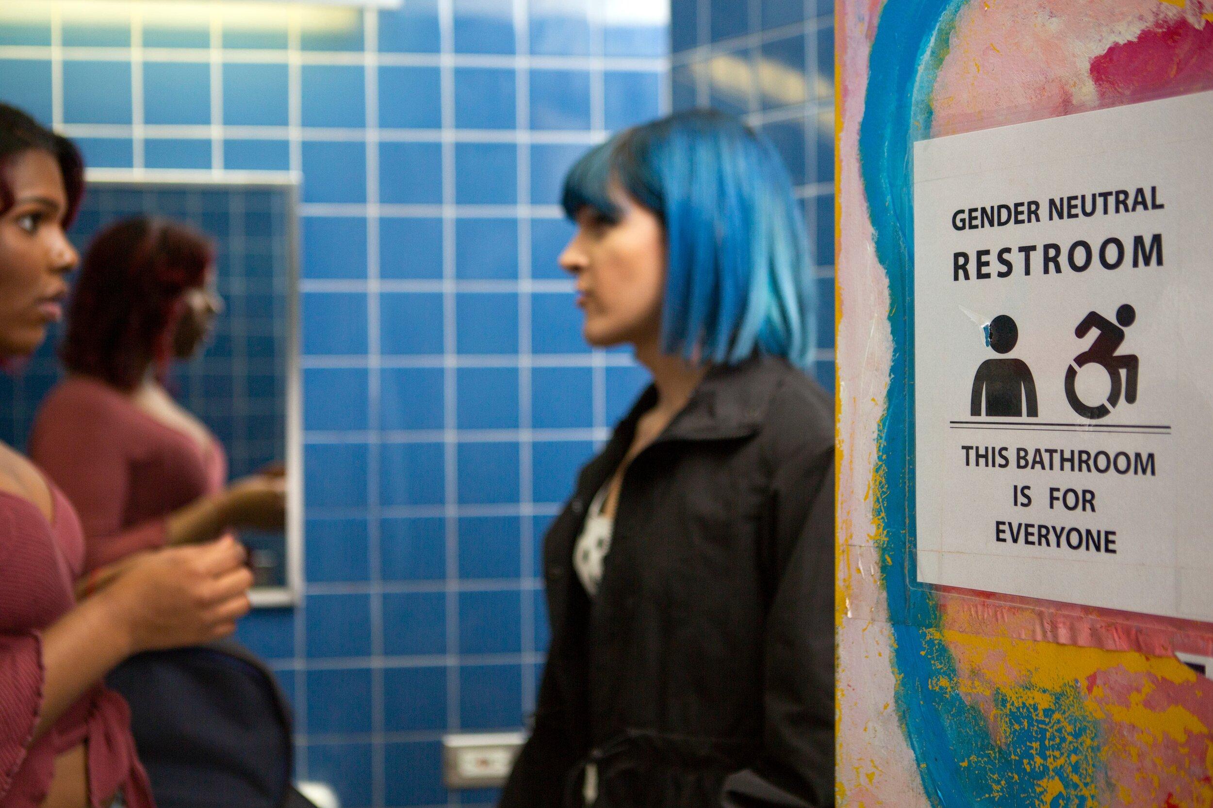 Two students in a gender neutral bathroom (1).jpg