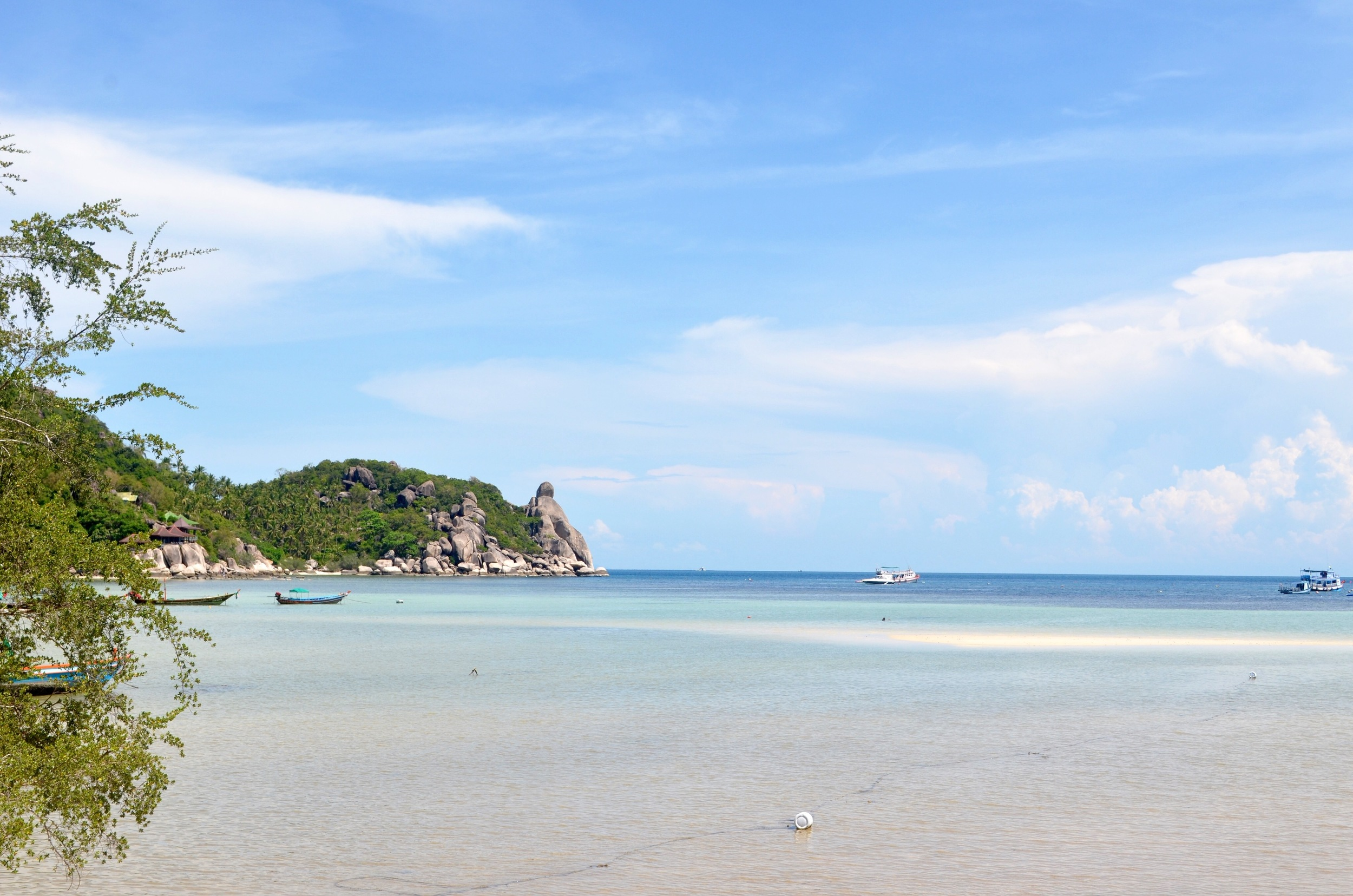 one of many beautiful beaches in Koh Tao with clear, blue water...