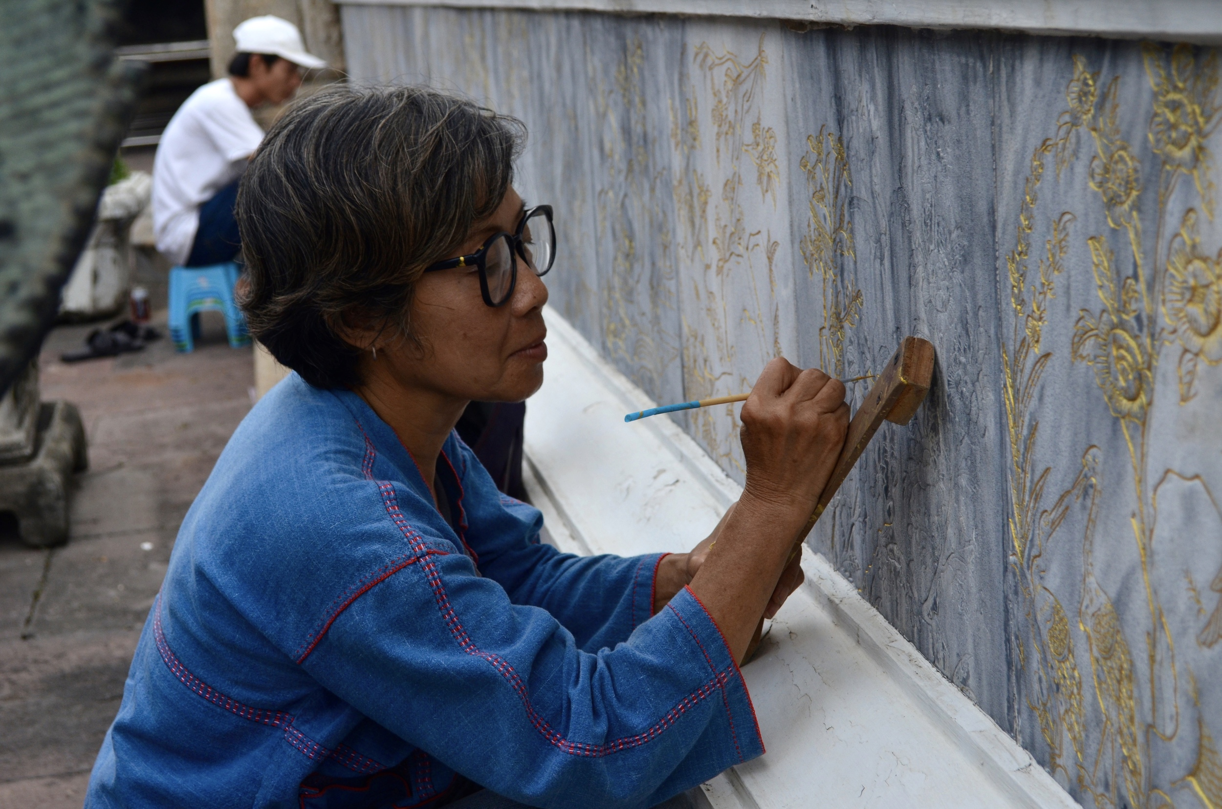 This painter, was working on a temple wall in Bangkok. She was pleased when I asked to take her photo, and then inquired about her job and the process.