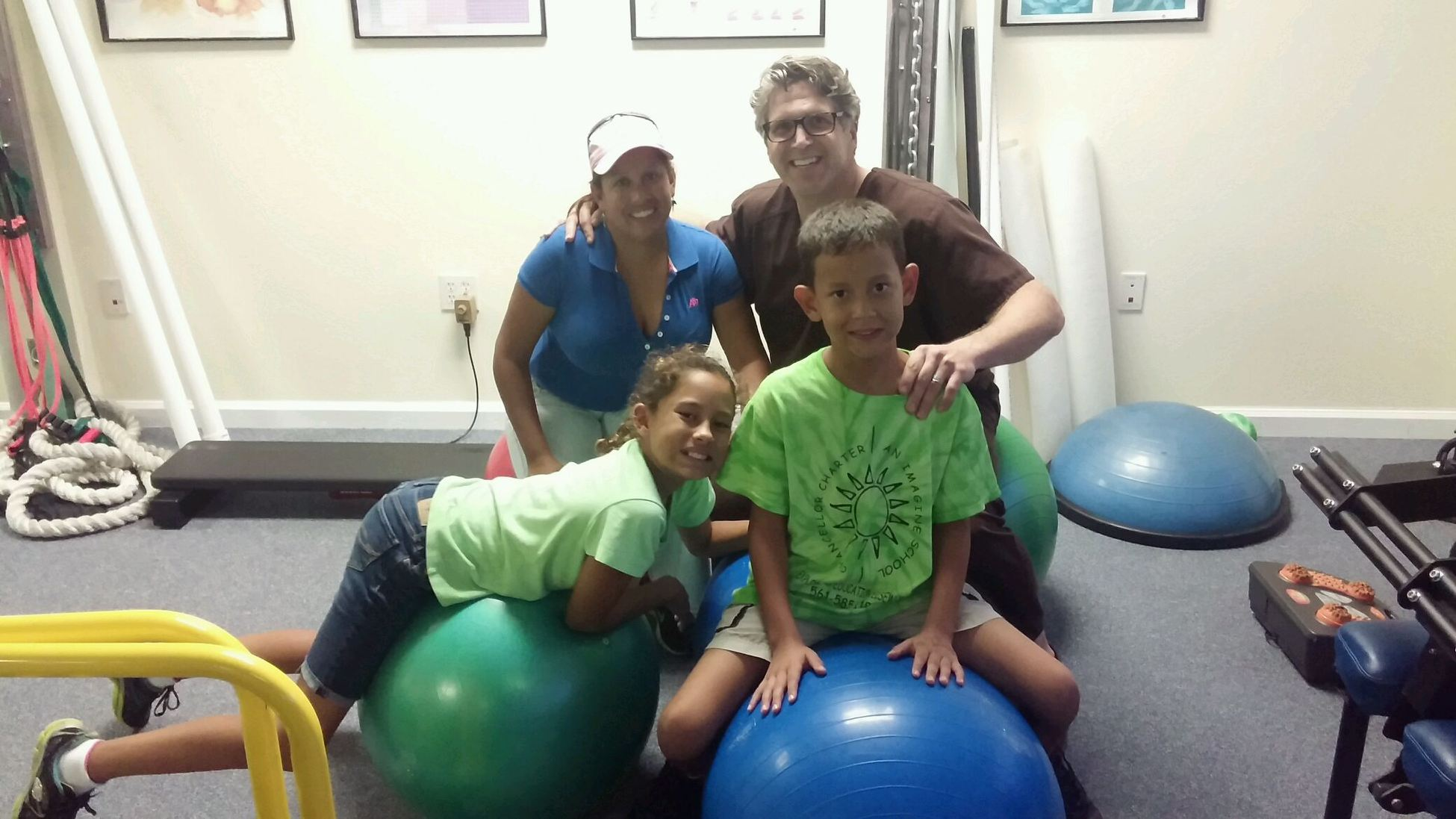 Children exercising with physical therapy.