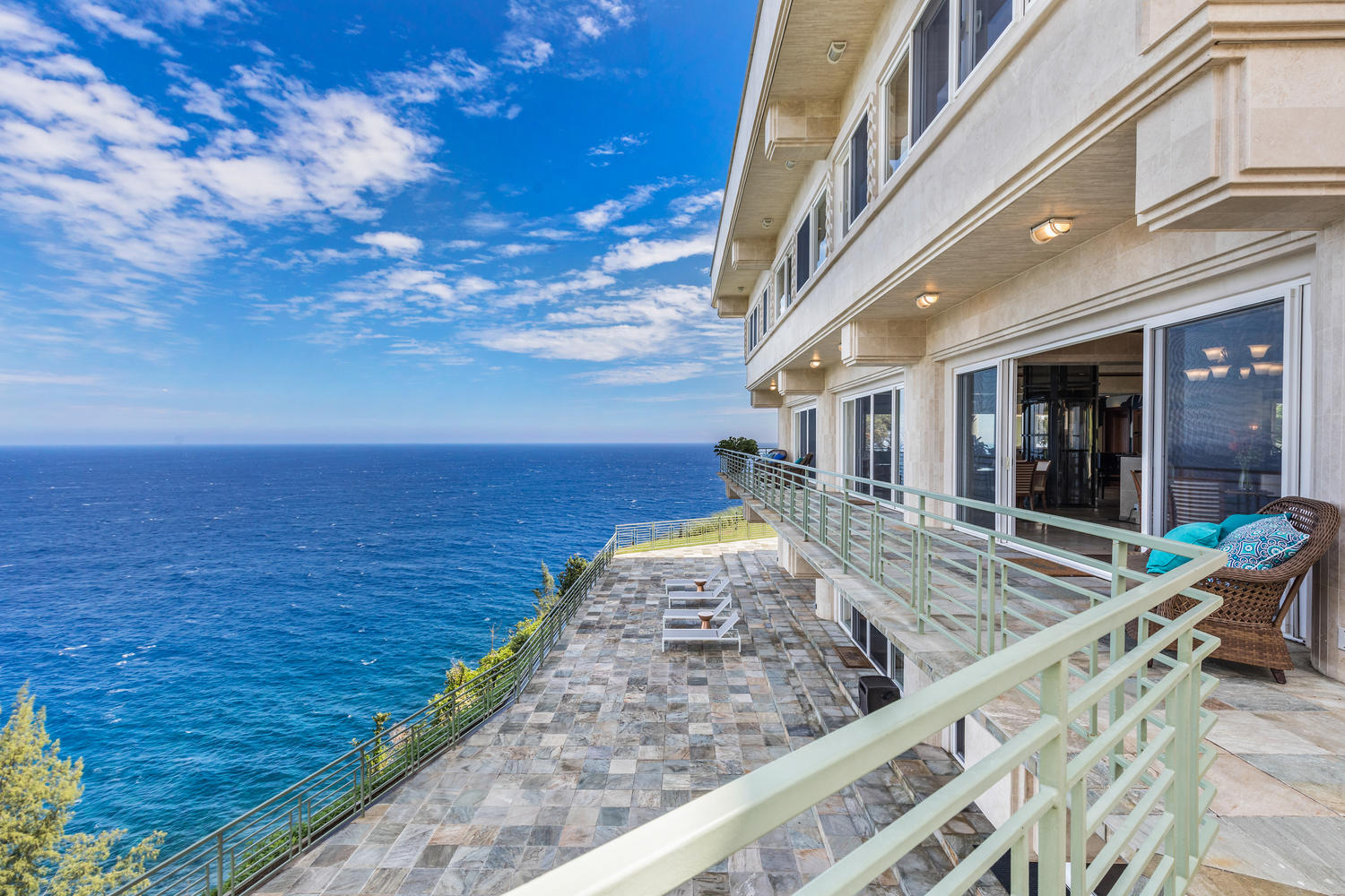 """Spacious cliff-side lanais provide ample outdoor living spaces and """"sea"""" forever views."""