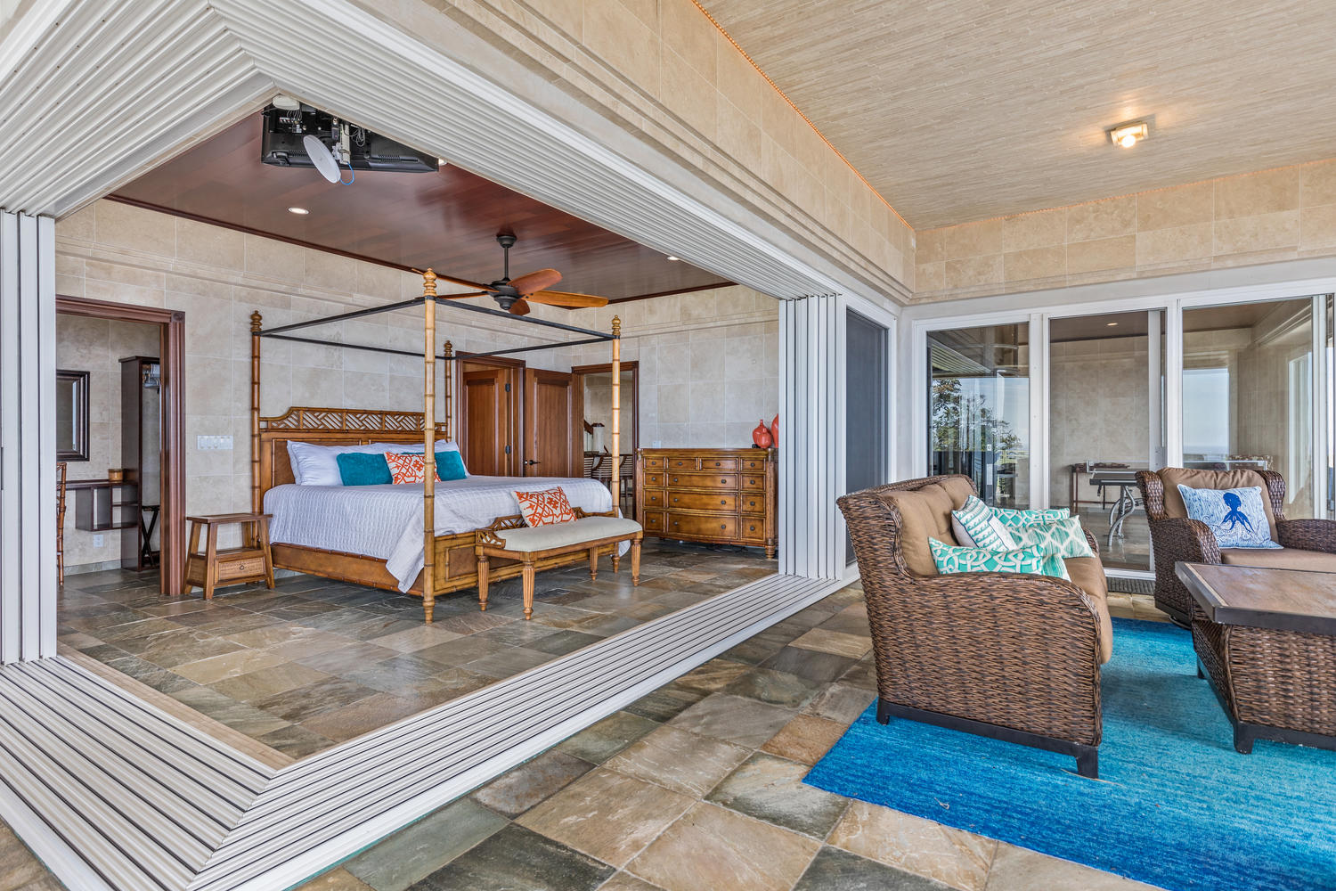 Bedroom with corner-free pocket doors to optimize view and natural light with private covered lanai.